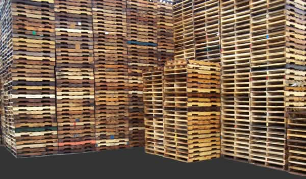 Stacks of Used Grade 'A' 4-way wooden Pallets